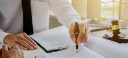 Man writing regulatory rules